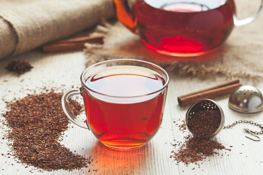 Healthy traditional organic rooibos tea with spices in rustic style with faded instagram filter on vintage wooden table