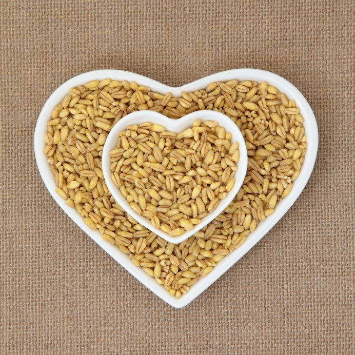 Kamut khorasan wheat in heart shaped dishes over hessian background.